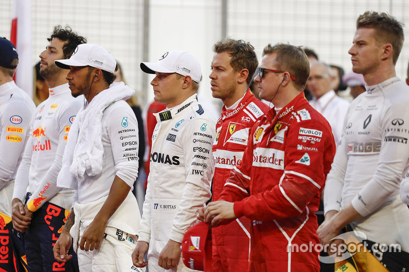 Daniel Ricciardo, Red Bull Racing,Lewis Hamilton, Mercedes AMG, Valtteri Bottas, Mercedes AMG, Sebastian Vettel, Ferrari, Kimi Raikkonen, Ferrari, and Nico Hulkenberg, Renault Sport F1 Team, line up for the national anthem