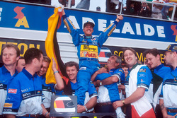 World Champion Michael Schumacher celebrates the Benetton team, Tom Walkinshaw and Flavio Briatore