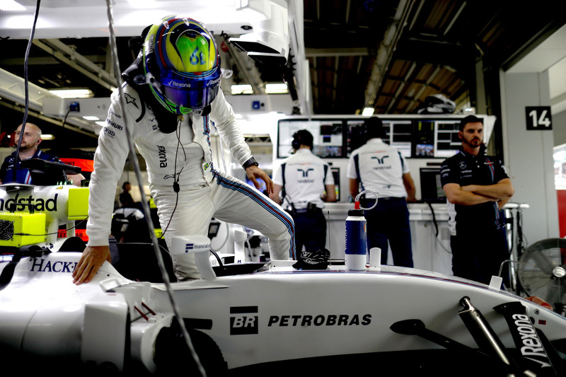 Felipe Massa, Williams FW38climbs in to his car