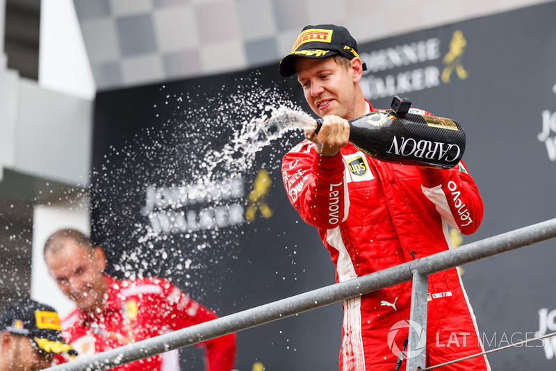 Sebastian Vettel, Ferrari celebrates with the champagne on the podium