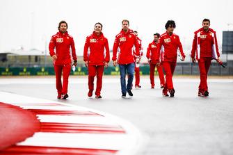 Sebastian Vettel, Ferrari, walks the track with his team.
