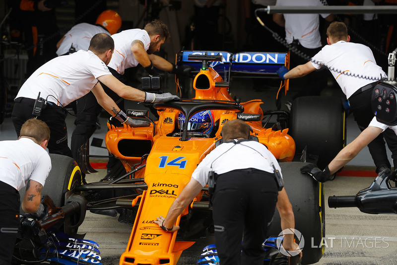 Fernando Alonso, McLaren MCL33, is returned to the McLaren garage