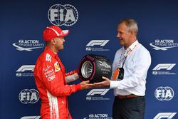 Sebastian Vettel, Ferrari receives the Pirelli Pole Position Award in parc ferme