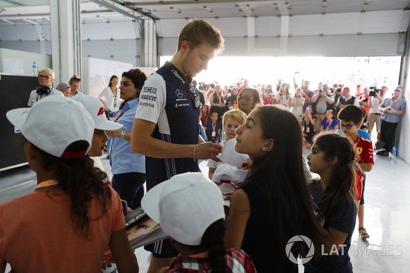 Sergey Sirotkin, Williams Racing, signs autographs for children