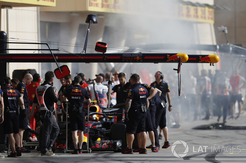 Smoke in the pit lane as Max Verstappen, Red Bull Racing RB14 Tag Heuer, makes a pit stop