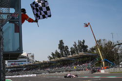 Esteban Ocon, Sahara Force India VJM10 takes the chequered flag at the end of Qualifying