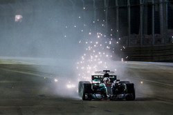 Lewis Hamilton, Mercedes AMG F1 W08, kicks up sparks under braking
