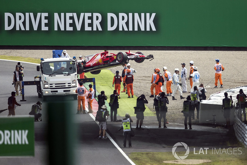 The crashed car of Kimi Raikkonen, Ferrari SF70H is recovered by marshals after spinning off