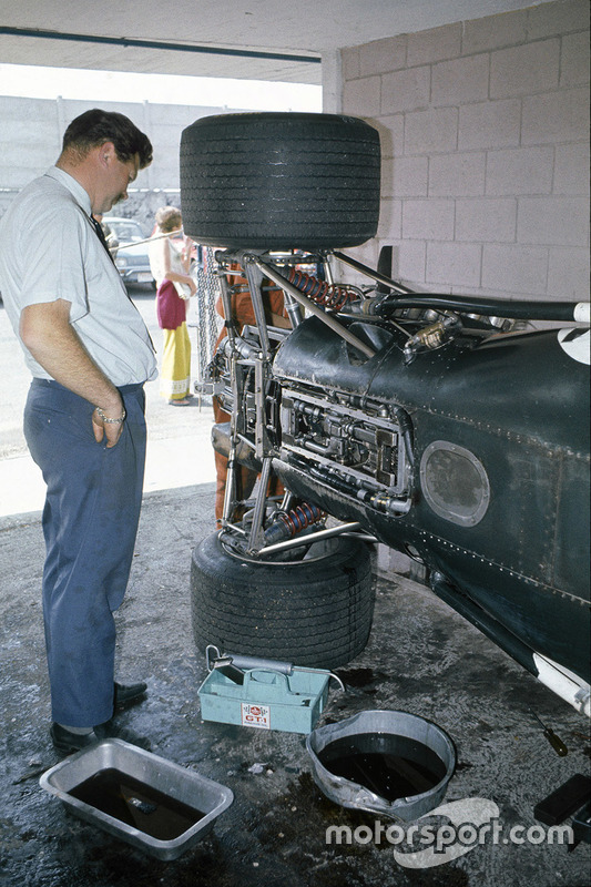 1969, Tim Parnell stands next to the BRM P138