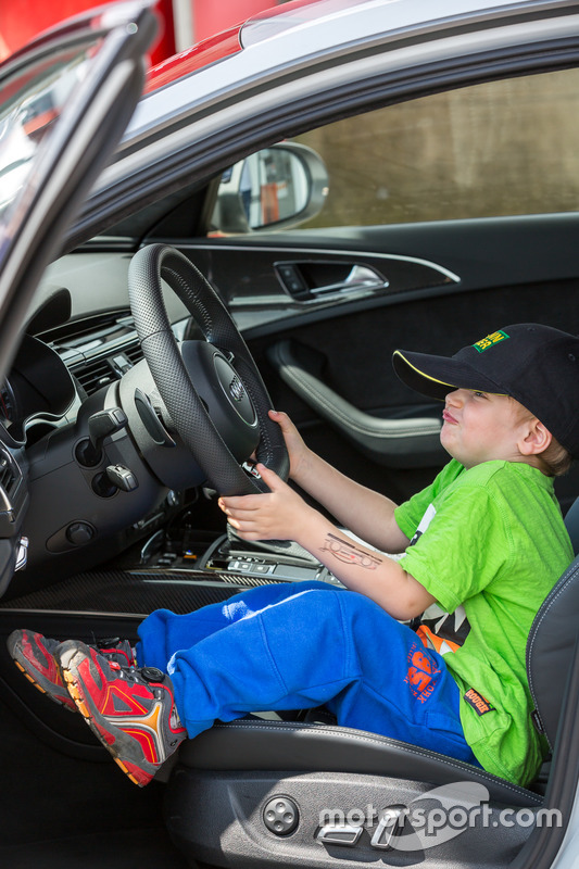 Child playing in Audi Intervention Car