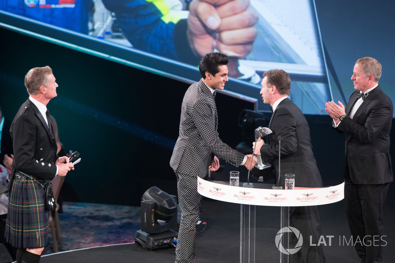 Enaam Ahmed on stage with Christian Horner and Martin Brundle to accept the British Club Driver of t