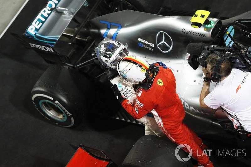 Valtteri Bottas, Mercedes AMG F1, 2nd position, congratulates Sebastian Vettel, Ferrari, 1st position, on victory in Parc Ferme