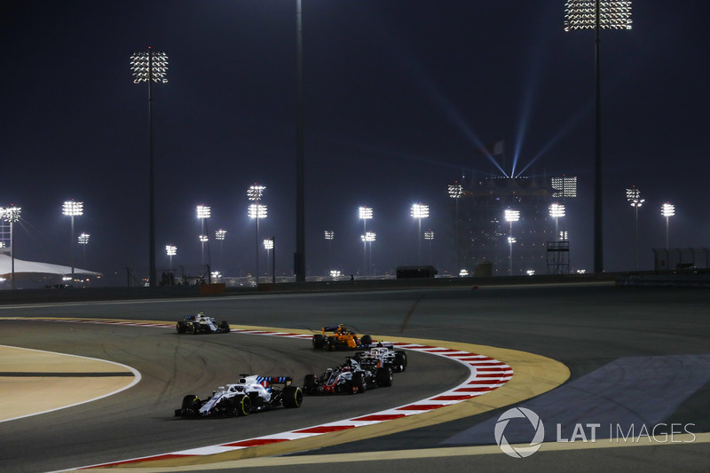 Lance Stroll, Williams FW41 Mercedes, leads Romain Grosjean, Haas F1 Team VF-18 Ferrari, Charles Lec