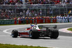 Jacques Villeneuve in the Gilles Villeneuve Ferrari 312T3, waves to spectators