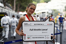A grid girl holds a message for Lance Stroll, Williams Racing