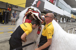 Renault Sport F1 Team mechanics and people in dragon costumes