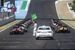Cars line up on the grid for the start