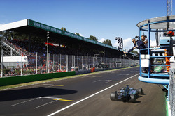 Lewis Hamilton, Mercedes AMG F1 W08, takes the chequered flag to win the race