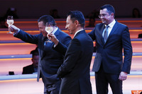 Yusuke Hasegawa, Senior Managing Officer, Honda, Zak Brown, Executive Director of McLaren Technology Group, and Eric Boullier, Racing Director, McLaren, toast the McLaren MCL32