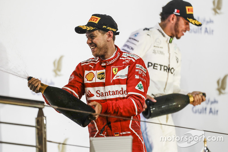 Sebastian Vettel, Ferrari, race winner, Lewis Hamilton, Mercedes AMG, second place