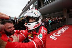 Sebastian Vettel, Ferrari celebrates with his team in parc ferme
