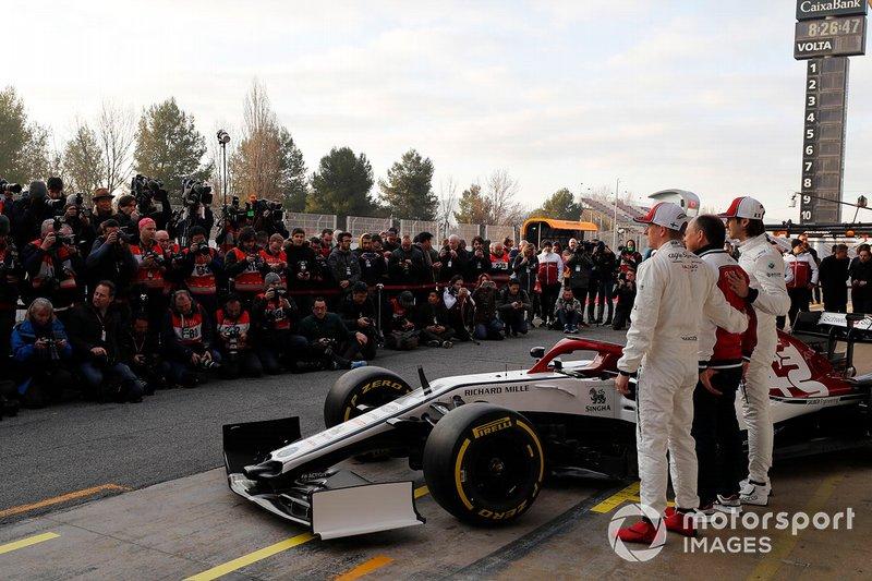 Kimi Raikkonen, Alfa Romeo Racing, Frederic Vasseur, Alfa Romeo Racing, Team Principal and Antonio Giovinazzi, Alfa Romeo Racing with the new Alfa Romeo Racing C38