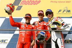 Podium: second place Loris Capirossi, Ducati; Race winner Casey Stoner; third place  Valentino Rossi, Yahmaha