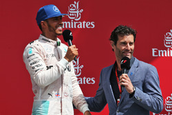The podium (L to R): race winner Lewis Hamilton, Mercedes AMG F1 with Mark Webber, Porsche Team WEC Driver / Channel 4 Presenter