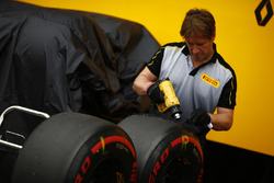 A Pirelli engineer works on some Super Soft tyres
