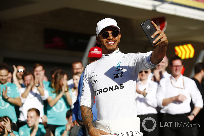 Lewis Hamilton, Mercedes AMG F1, takes a selfie as he celebrates winning the Constructors' Championship with his team