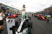 Lewis Hamilton, Mercedes AMG F1, celebrates taking pole position on the pit straight