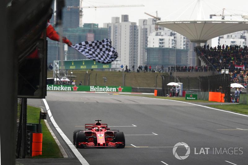 Pole sitter Sebastian Vettel, Ferrari SF71H takes the chequered flag at the end of Qualifying