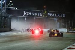 Daniel Ricciardo, Red Bull Racing RB13, passes Sebastian Vettel, Ferrari SF70H, as the latter crashes out