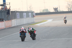 Marco Melandri, Ducati Team, Tom Sykes, Kawasaki Racing over the finish line