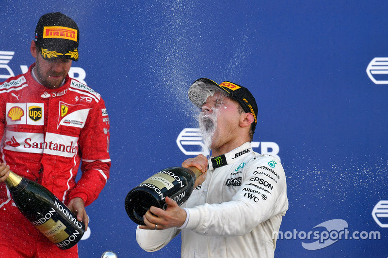 Sebastian Vettel, Ferrari and Race winner Valtteri Bottas, Mercedes AMG F1