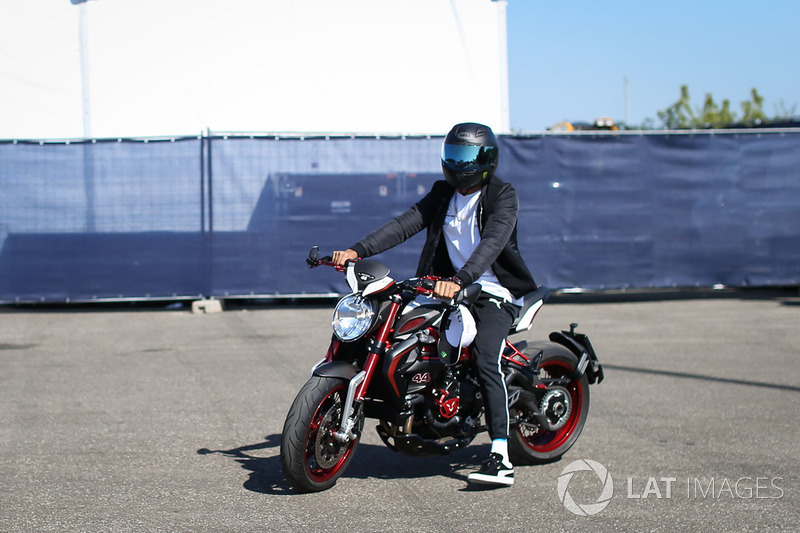 Lewis Hamilton, Mercedes AMG F1 W08 arrives on his MV Agusta Dragster RR LH44 Limited Edition motorbike