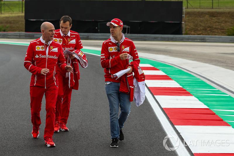 Sebastian Vettel, Ferrari walks the track with Jock Clear, Ferrari Chief Engineer, Riccardo Adami, Ferrari Race Engineer