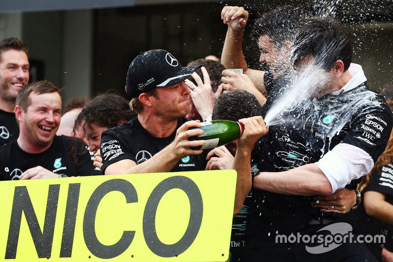 Race winner Nico Rosberg, Mercedes AMG F1 celebrates winning the constructors' championship with Toto Wolff, Mercedes AMG F1 Shareholder and Executive Director and the team