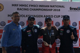 Race winner Dhruv Behl, second place Pratik Sonawane, third place Saurav Bandyopadhyay with Sirish Vissa, head, Volksagen Motorsprot India