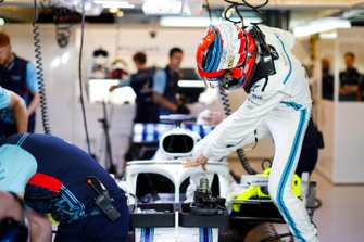 Robert Kubica, Williams Martini Racing, enters his cockpit in the team's garage