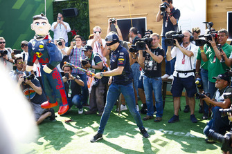 A blindfolded Max Verstappen, Red Bull Racing, hits an impersonator with a stick
