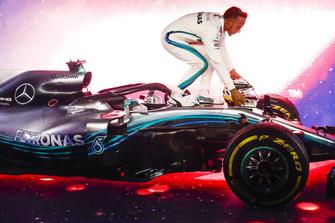 A huge crowd gathers as Lewis Hamilton, Mercedes AMG F1 W09 EQ Power+, 1st position, celebrates beneath the podium