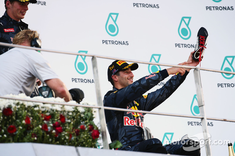 Race winner Daniel Ricciardo, Red Bull Racing celebrates on the podium with his race boot