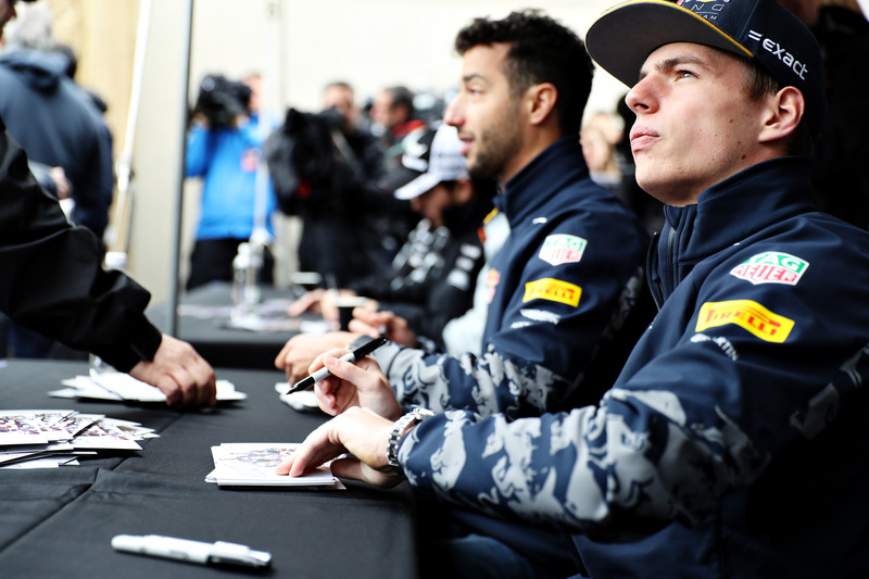 Max Verstappen, Red Bull Racing  and Daniel Ricciardo, Red Bull Racing sign autographs for fans