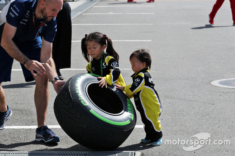 Young Renault Sport F1 Team fans with a Pirelli tyre