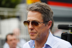 Actor Hugh Grant arrives in the paddock