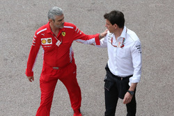 Maurizio Arrivabene, Team Principal, Ferrari, with Toto Wolff, Executive Director (Business), Mercedes AMG