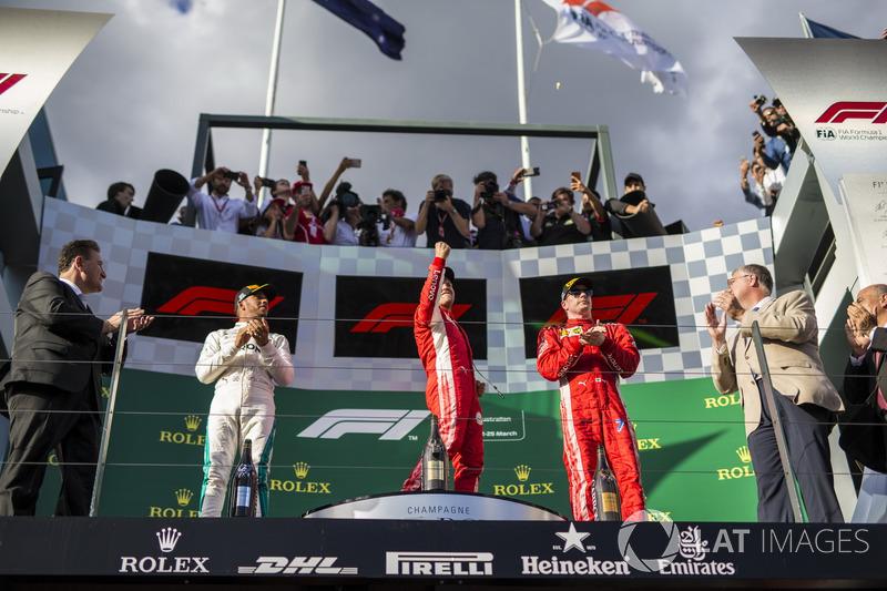 Lewis Hamilton, Mercedes-AMG F1, Sebastian Vettel, Ferrari and Kimi Raikkonen, Ferrari celebrate on