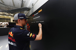 Max Verstappen, Red Bull Racing, signs the Pirelli hot laps board