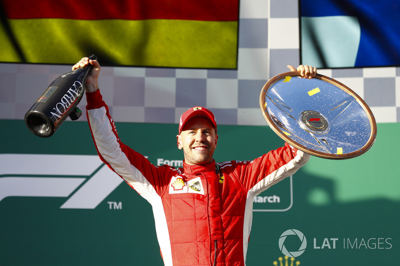 Sebastian Vettel, Ferrari, celebrates victory on the podium